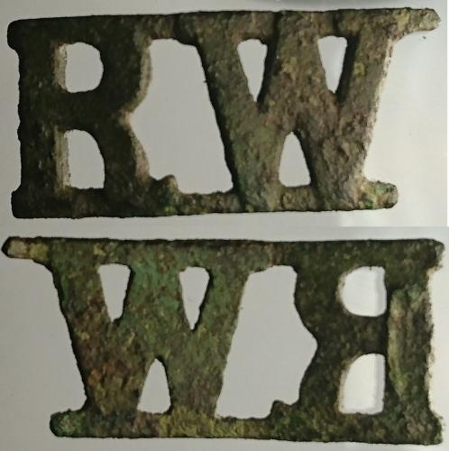 Date: ?Type: Royal Welsh Fusiliers Shoulder TitleFound by: Tom Connell