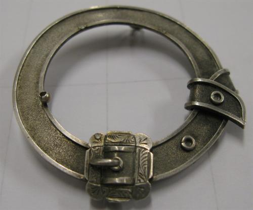 Date: ?Type: Belt BuckleFound by: Phil Moy